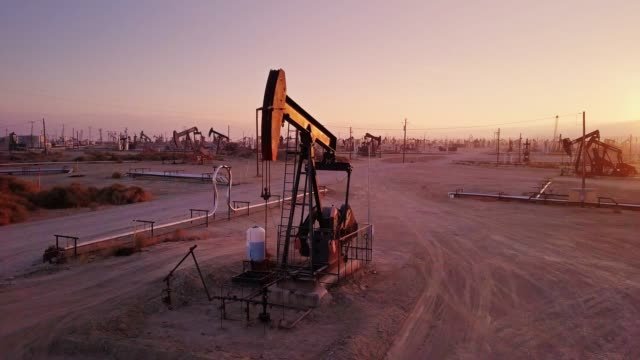 nodding pumpjack among many in midway-sunset oil field, kern county, california - fossil fuel stock videos & royalty-free footage