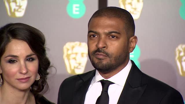 noel clarke with wife iris clarke, on red carpet at 2019 bafta film awards - performer stock videos & royalty-free footage
