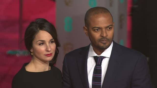 noel clarke with wife iris clarke on red carpet at bafta film awards 2016 - performer stock videos & royalty-free footage