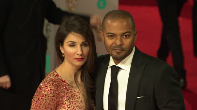 noel clarke with wife iris, on red carpet at 2015 bafta film awards - performer stock videos & royalty-free footage