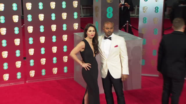 noel clarke with wife iris, on red carpet at 2017 bafta film awards - performer stock videos & royalty-free footage