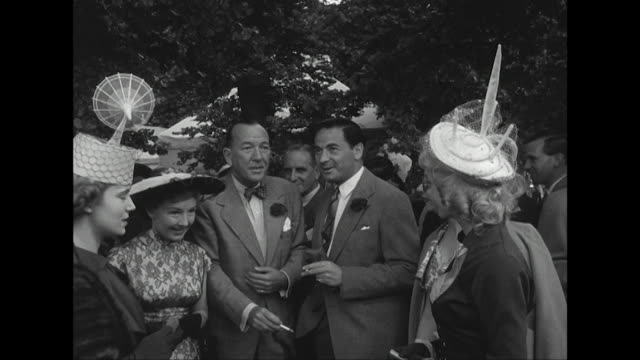 noel coward chats to a group of people at a theatrical charity garden party held at the royal chelsea hospital - hat stock videos & royalty-free footage