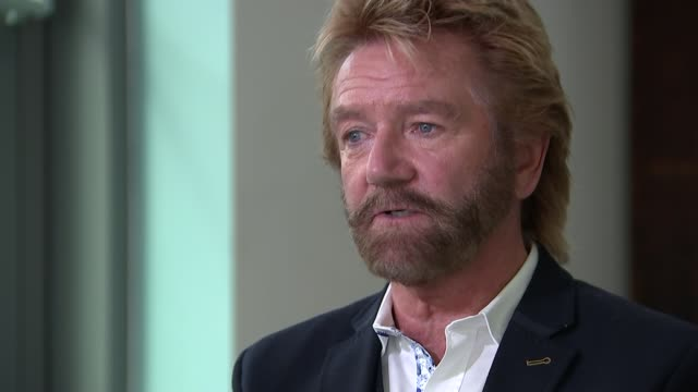 noel edmonds' court case against lloyds bank; london: int noel edmonds interview sot - noel edmonds stock videos & royalty-free footage