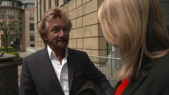 stockvideo's en b-roll-footage met noel edmonds gatecrashes lloyds agm edinburgh ext noel edmonds interview with reporter sot close shot wall as people along past low angle view former... - noel edmonds