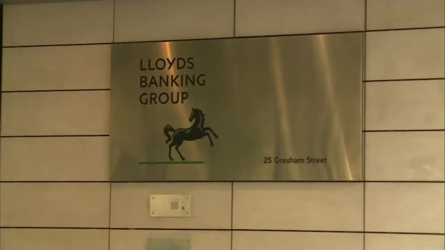 noel edmonds gatecrashes lloyds agm r28071607 / london ext lloyds banking group headquarters 'lloyds banking group 'sign pull out entrance - banking sign stock videos & royalty-free footage