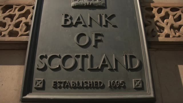noel edmonds gatecrashes lloyds agm scotland edinburgh ext various of stone faces on wall low angle view of the former bank of scotland headquarters... - noel edmonds stock videos & royalty-free footage