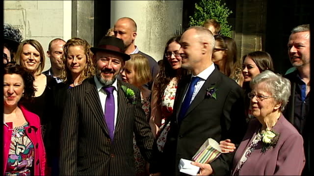 Noel Regan and Matthew Johnson's Stoke Newington wedding EXT Wedding confetti thrown over grooms / Grooms pose for photographs Noel Regan and Matthew...