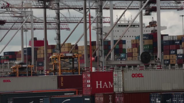 Noell straddle carrier move containers around the dockside after unloading from the CMA CGM SA Marco Polo container ship at the Port of Southampton...