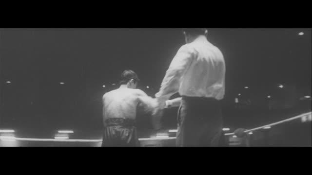 noguchi puts up a good fight/world flyweight title fight at kuramae kokukikan thai champion kingpetch vs noguchi yujiro ishihara in spectator seat... - world title stock videos and b-roll footage