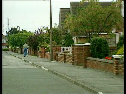 woman jailed; england: teesside: stockton: knayton grove: lbv man pushing pram away down road where helen stephens lives music overlay: whitney... - whitney houston stock-videos und b-roll-filmmaterial