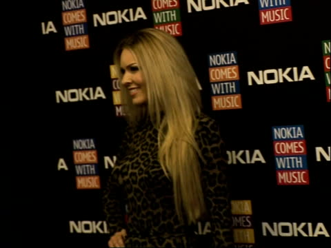 'nokia comes with music' launch party: celebrity arrivals and interviews; **swearword heard in background** zoe salmon posing for photocall / close... - zoe salmon stock videos & royalty-free footage