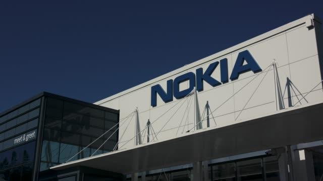 nokia corporation logo blur - logo stock videos & royalty-free footage
