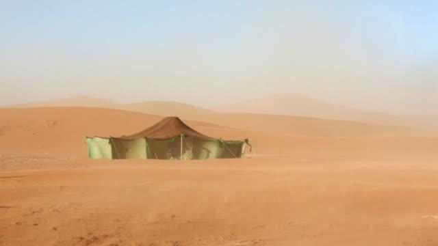 Nomad tent in sand storm, Erg-Chigaga sand dunes. Sahara Desert, Mhamid, Morocco