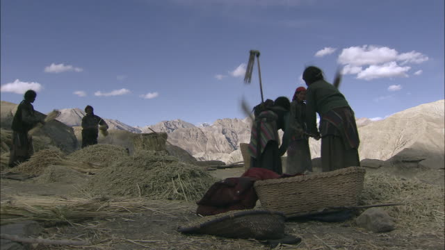 ws pan nomad tying prayer flags / himalayas, upper dolpo, nepal  - threshing stock videos & royalty-free footage