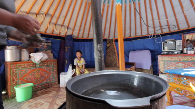 MS Nomad woman cleaning pot / Central-south Mongolia, Mongolia