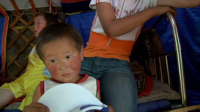 ms nomads children in yurt / central-south mongolia, mongolia - sun visor stock videos & royalty-free footage