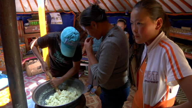 ms nomads making cheese in yurt / central-south mongolia, mongolia - mongolia video stock e b–roll