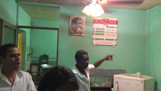 non tourist cafeteria with picture of che guevara in the wall the server addresses the tourist saying that he would sell the photo as wellcuban... - ceiling fan stock videos & royalty-free footage