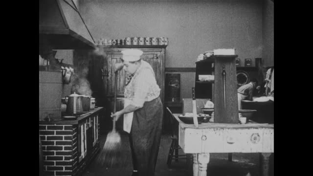 1918 Nonplussed chef (Fatty Arbuckle) dances as he throws kitchen knife
