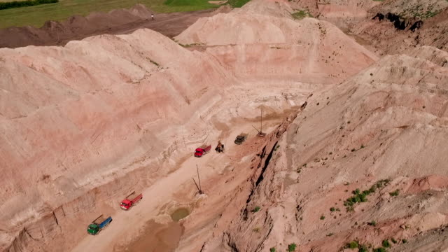 non-urban scene. lorries in sand quarry - pit mine stock videos and b-roll footage