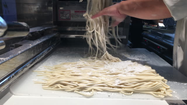 noodle shop employees are making noodles - noodles stock videos & royalty-free footage