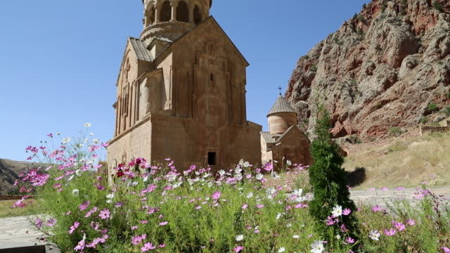 noravank monastery , flowers in the front of surb astvatsatsin church - eastern european culture stock videos and b-roll footage