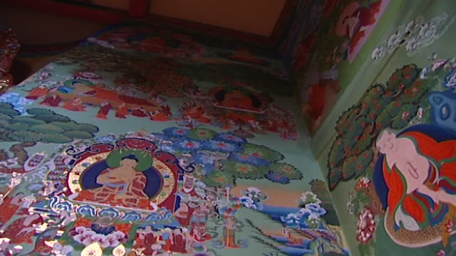 norbulingka institute. low-angle view of a mural at the deden tsuglagkhang temple in dharamsala. - history stock videos & royalty-free footage