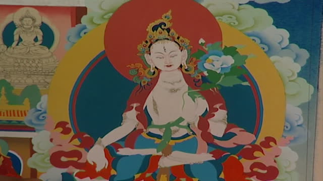 norbulingka institute. on a colourful section of a thangka depicting buddha in lotus position. norbulingka institute is dedicated to the preservation... - cross legged stock videos & royalty-free footage