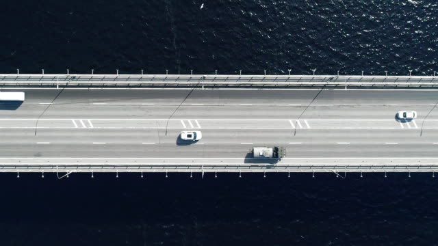 nord aerial view of highway and bridge in city on a sun day - above stock videos & royalty-free footage