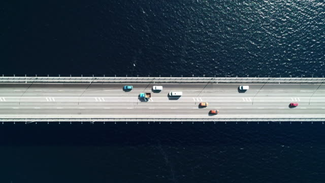 nord aerial view of highway and bridge in city on a sun day - directly above stock videos & royalty-free footage