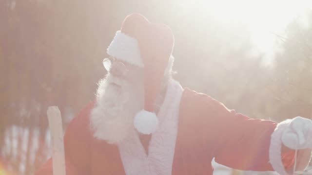 nordic santa claus in bright sunlight (slow motion) - christmas gift stock videos & royalty-free footage
