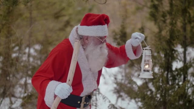 Nordic Santa Claus searching the way in the forest (slow motion)