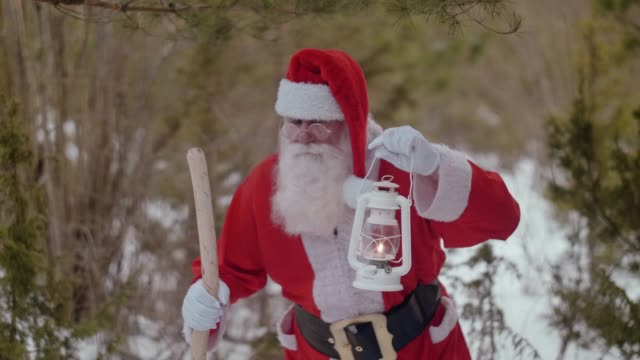 Nordic Santa Claus walking in the forest (slow motion)