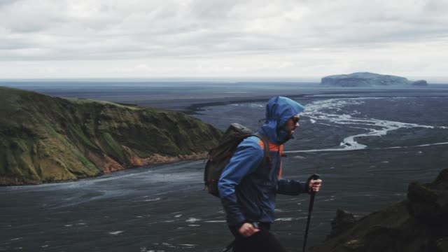 nordic walking in volcanic landscape - exploration video stock e b–roll