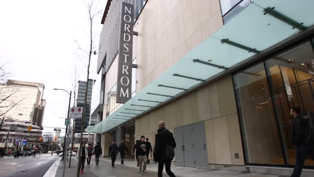 stockvideo's en b-roll-footage met nordstrom inc signage is displayed over a store in downtown vancouver british columbia canada on wednesday feb 17 2016 nordstrom inc is scheduled to... - nordstrom
