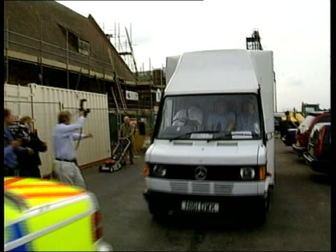 stockvideo's en b-roll-footage met tony martin appears in court; itn england: norfolk: king's lynn: ext police van and escort arriving at king's lynn magistrates court - verschijning