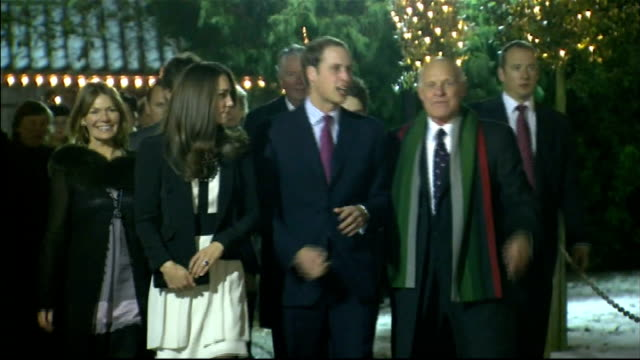 near fakenham photography** prince william and fiancee kate middleton arriving at christmas gala show - 2010 video stock e b–roll