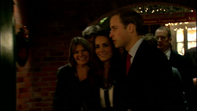 norwich prince william and fiancee kate middleton arriving at chritsmas gala - 2010 video stock e b–roll