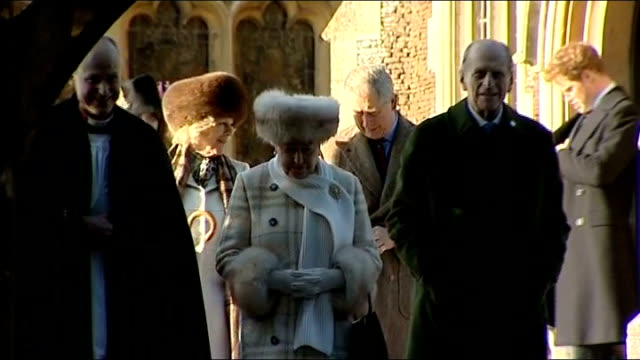 Norfolk Sandringham EXT Queen Elizabeth II away from church after attending christmas day service accompanied by Prince Philip Prince Charles Camilla...