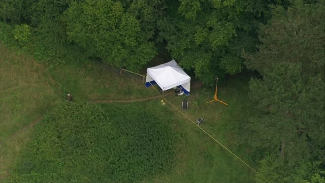 Aerials ENGLAND Norfolk East Harling of crime scene / forensics in field with tent