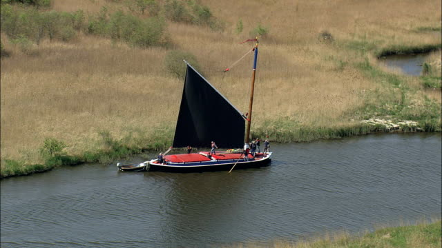 a norfolk wherry on the river bure  - aerial view - england, norfolk, north norfolk district, united kingdom - norfolk england stock videos & royalty-free footage