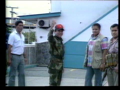 noriega on coup attempt:; panama: panama city: general manuel antonio noriega raising fist triumphantly cms noriega comments on usa involvement in... - panama city panama stock videos & royalty-free footage