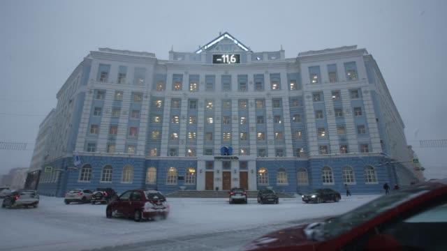 a norilsk nickel logo hangs above the entrance to the office of mmc norilsk nickel pjsc in norilsk russia on tuesday oct 17 photographer andrey... - moneta da 5 centesimi statunitensi video stock e b–roll