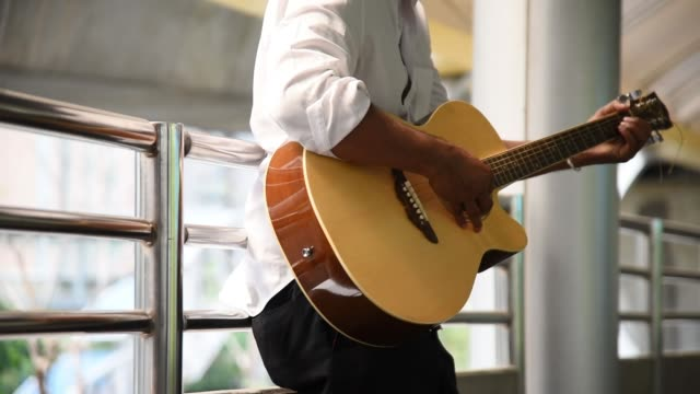 normal shot man play guitar with chord - musician stock videos & royalty-free footage