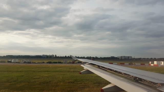4k normal speed of aeroplane runway flight take off late evening at heathrow airport united kingdom 3840x2160 - heathrow airport stock videos & royalty-free footage
