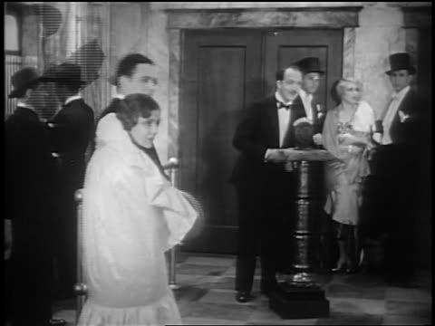 stockvideo's en b-roll-footage met norman brockenshire at premiere of glorifying the american girl in nyc / newsreel - 1927