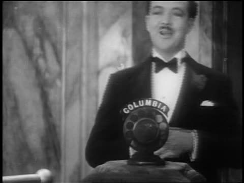 """norman brockenshire talking into mic at opening of """"glorifying the american girl"""" in nyc - 1927 stock videos & royalty-free footage"""