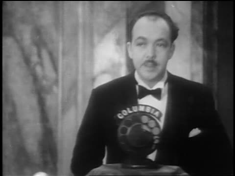 """norman brockenshire talking into mic at premiere of """"glorifying the american girl"""" in nyc - 1927 stock videos & royalty-free footage"""
