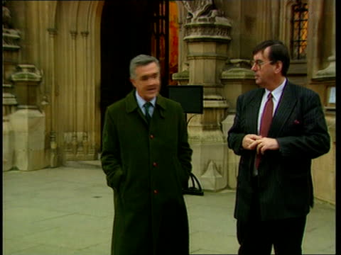 norman lamont votes against government on europe; ext london norman lamont out of house carrying briefcase pull out as down steps twds waiting... - douglas hurd stock-videos und b-roll-filmmaterial