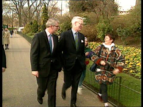 norman lamont votes against government on europe; ext/day st james park lms john major & douglas hurd strolling twds track back as they chat with... - douglas hurd stock-videos und b-roll-filmmaterial